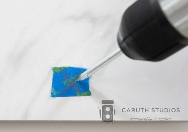 mark screw holes on tray