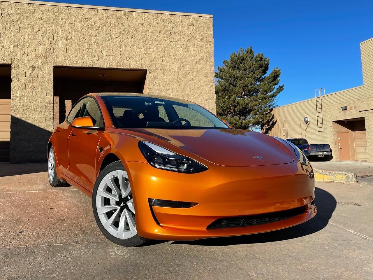 Tesla Model 3 Gloss Liquid Llumar window tint front side view