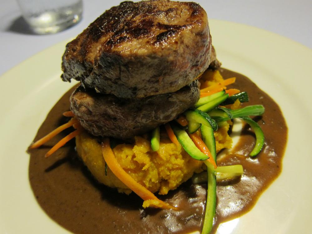 Sizzling Steak on a Mofongo bed Casita