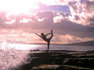 yoga on rocks at beach