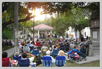 People enjoying the music in the Plaza