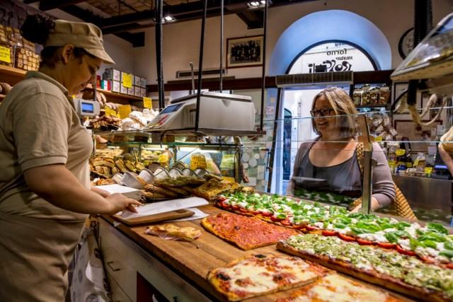 Pizza by the slice at Antico Forno Roscioli bakery in Rome