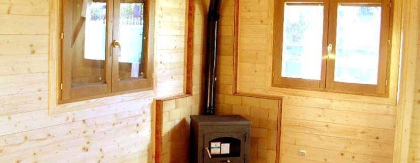 Estufa en una casa de madera Carbonell