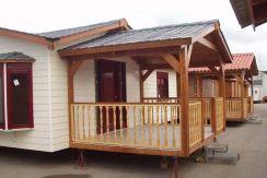 casa de madera Hercules de Casas Carbonell con fachada de Cedral Clasic Wood color blanco