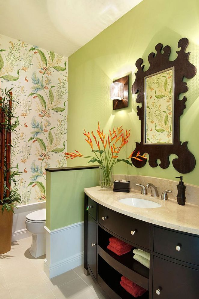 Mirror-frame-seems-to-complement-the-pattern-of-Thibaut-wallpaper-in-the-powder-room