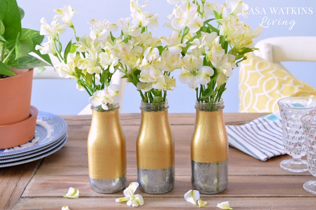DIY-Mercury-Glass-and-Gold-Toned-Milk-Bottle-Vase