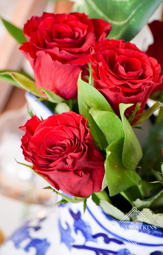 beautiful red roses in blue pitcher for Valentine's day decor