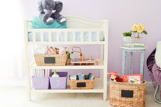 Baskets used for storage of books and diaper supplies