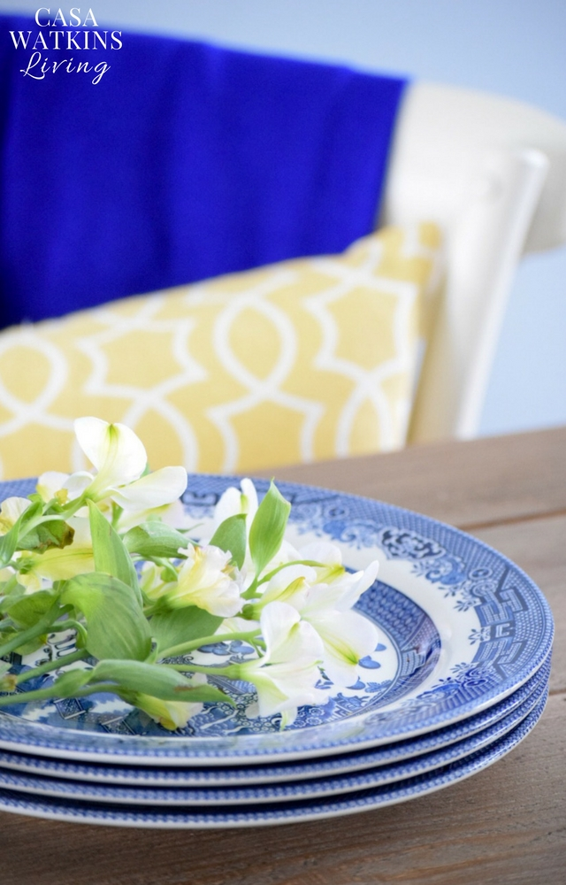 Blue willow plates paired with geometric yellow pillows