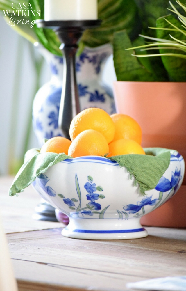 Use fruits in a ceramic bowl for seasonal decor