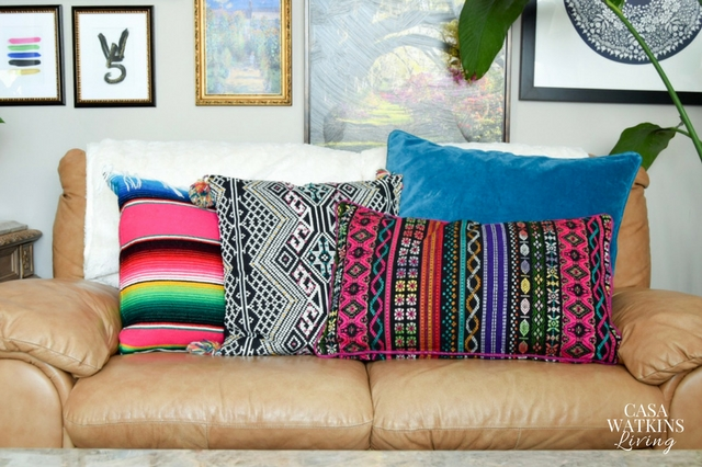 Mix and match global pillows to make a colorful couch