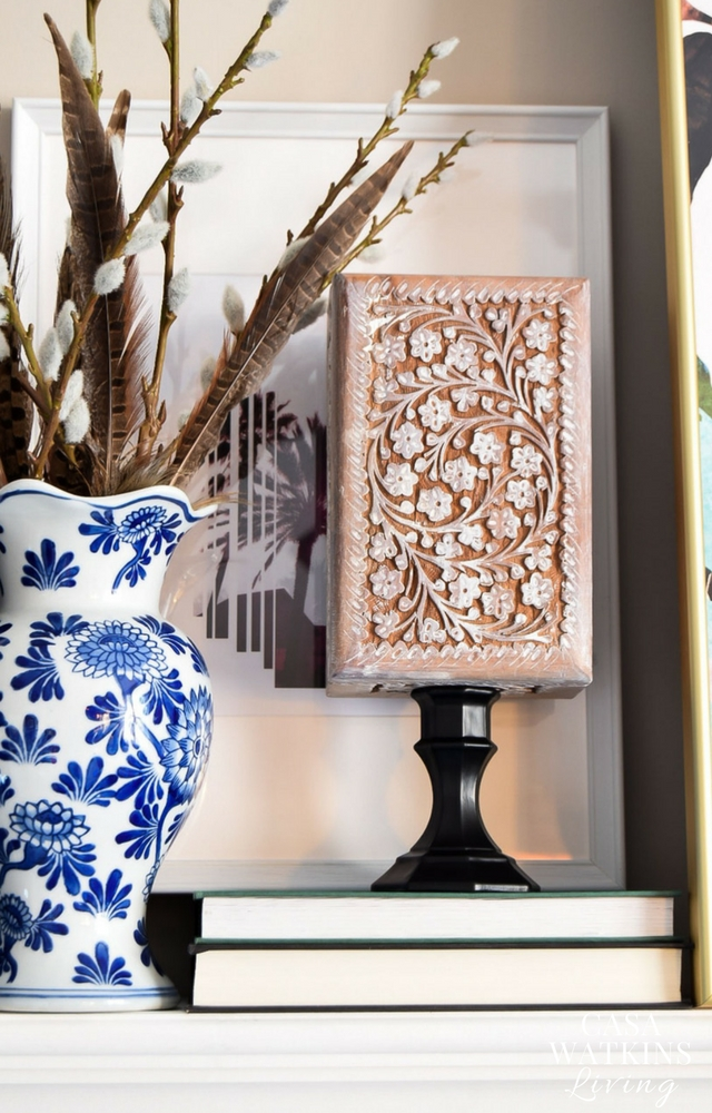 White wash wood carved box and place on a stand for easy sculpture art for mantel or shelf!