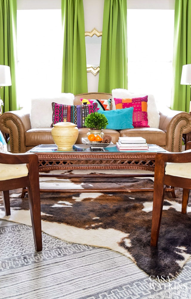 Decorating with layered cow hide rug