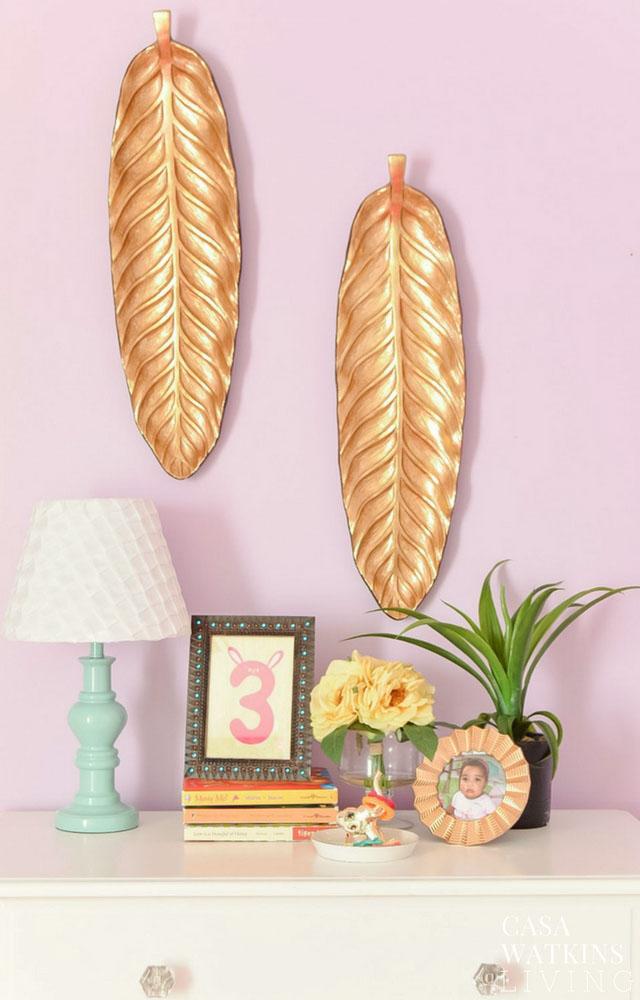 gold leaf banana leaf wall decor in girls boho room