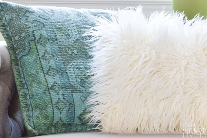 global boho style pillows in green and gray living room