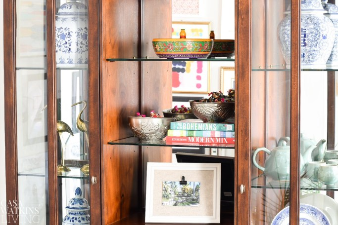 moroccan bowls and indian painted bowls decorated on a shelf with ginger jars