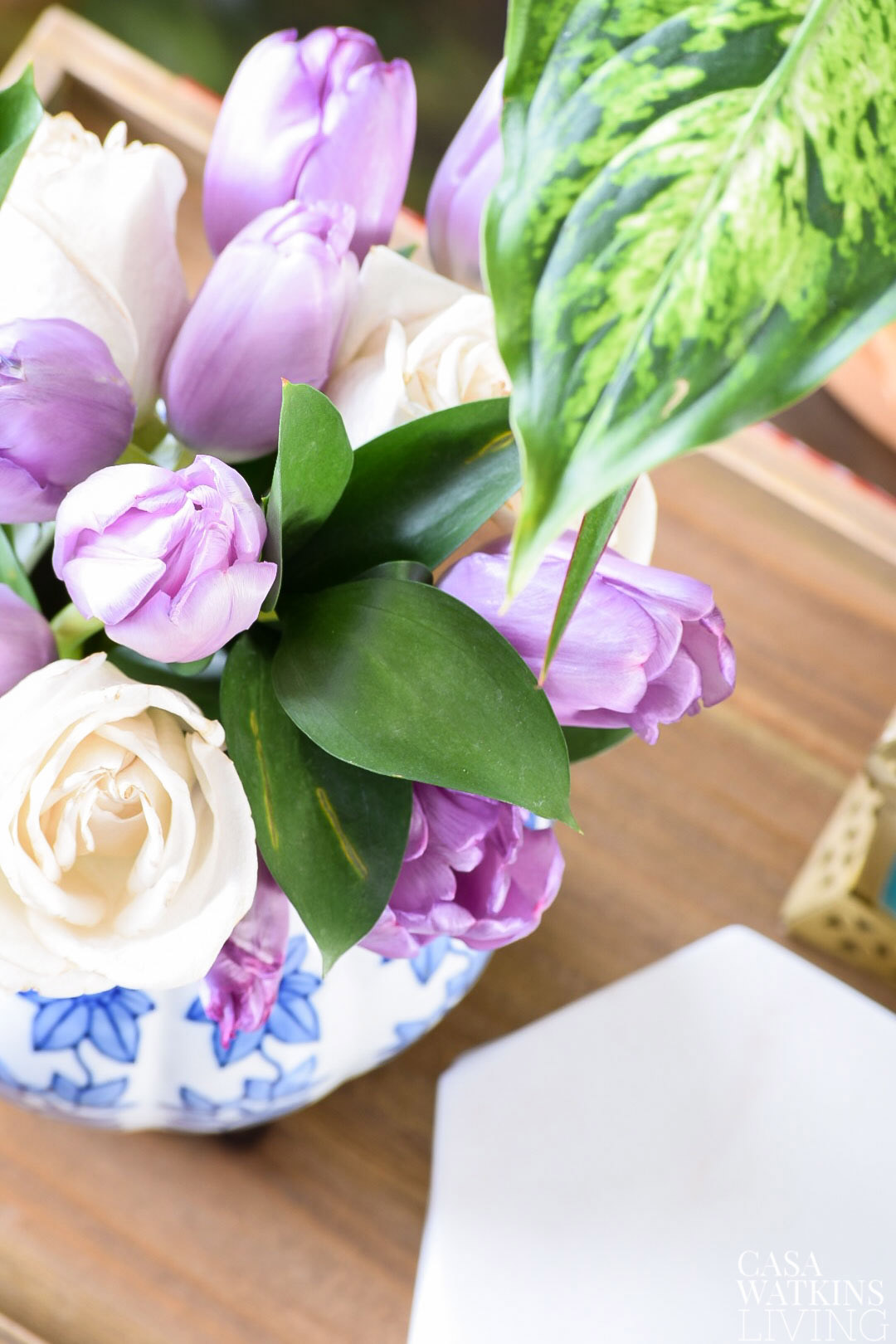 Beautiful purple tulips and white roses in blue vase. Plus great tips for keeping flowers lasting longer!