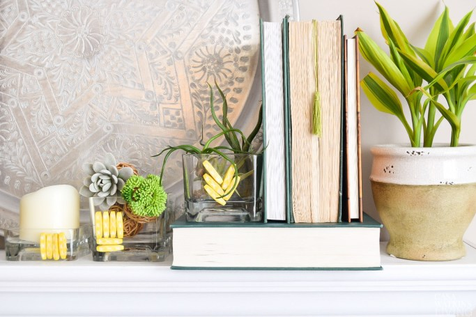 DIY vase with beads.  Styled with plants and candles!