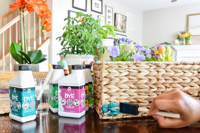 paint woven baskets and insert potted flowers for mother's day gift