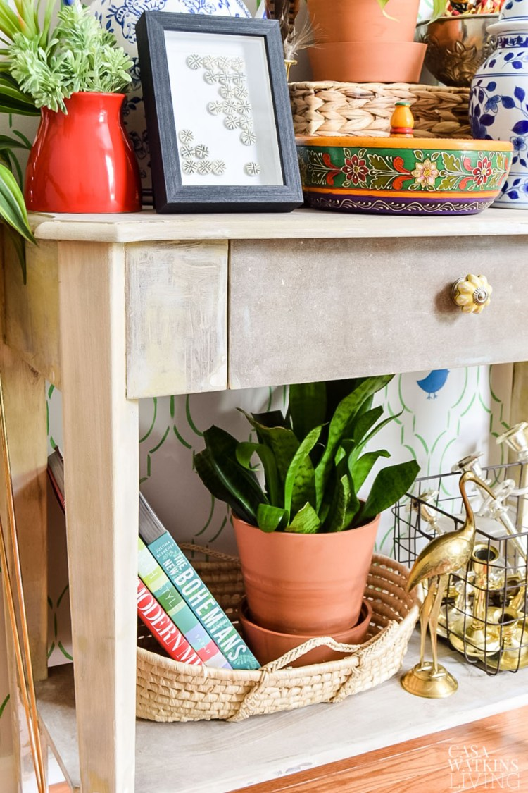 weathered table in global style entryway with plants