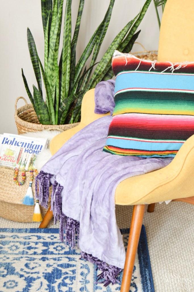 velvet blanket and mexican serape pillow for a boho corner nook
