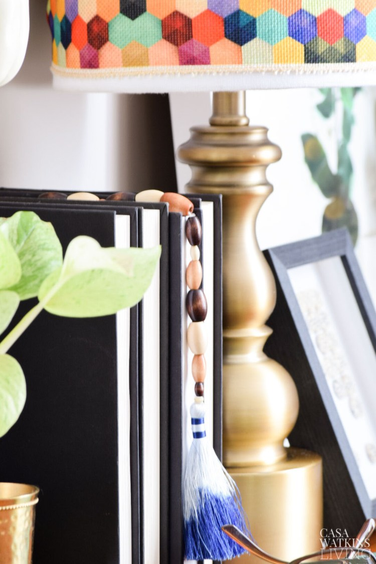 hang a diy tassel bookmark over books for desk decor