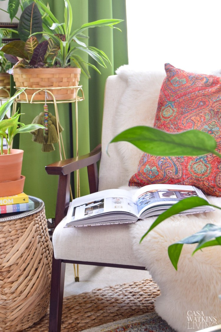 diy decorative tassel on plant stand in boho global style living room