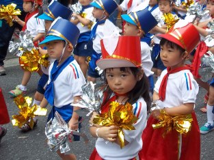 Adorable boys and girls marching in the parade