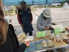 Sampling deep-fried shitake at Hiroshima Minato Marché