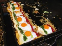 Omusoba, an egg omelette wrapped around yakisoba noodles and topped with an egg, ketchup and mayonaisse. Delicious!
