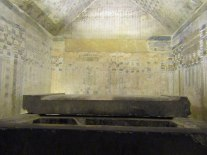 King Unas's funerary chamber with black stone sarcophagus.