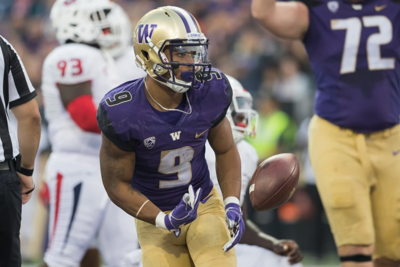 Myles Gaskin flips the ball after scoring
