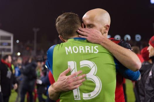 Jordan Morris gets a hug from Michael Bradley. ( Sounders FC)
