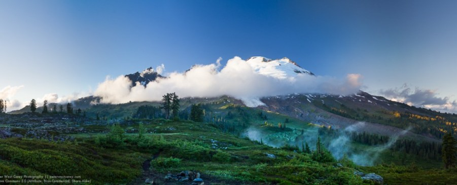 Sunset, clouds and rich forest colors combine to make Mount Baker appear particularity stunning.