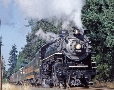 The SP&S, Spokane, Portland & Seattle Steam Locomotive under full power on a promotional run through Northwest forests.
