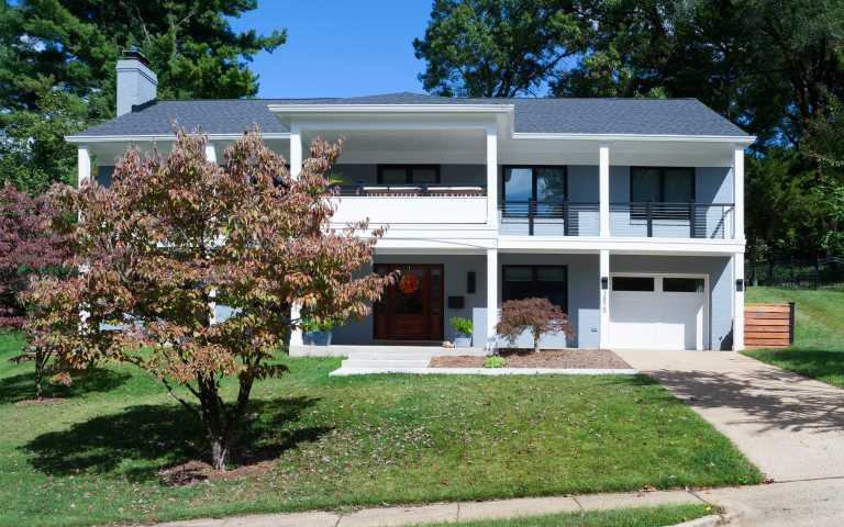 addition exterior two level front porch columns light blue white curb appeal