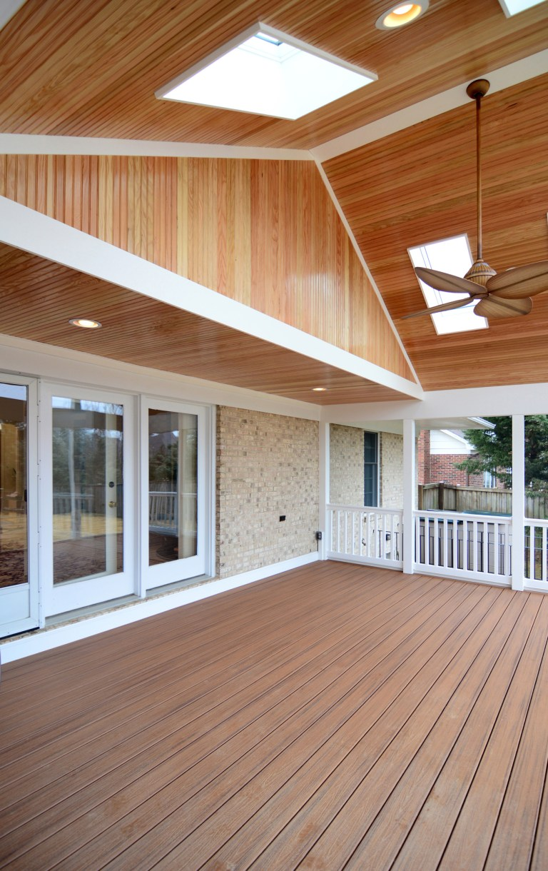 screened in porch addition sliding glass doors vaulted wood ceiling with skylights and ceiling fan