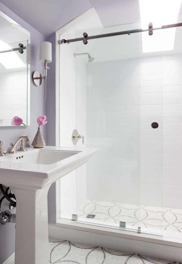 shower stall with glass door and skylight tile pattern on floor light purple walls