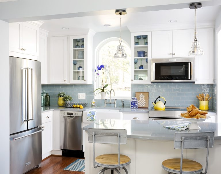 traditional farmhouse kitchen light blue and wood floors peninsula stainless steel appliances