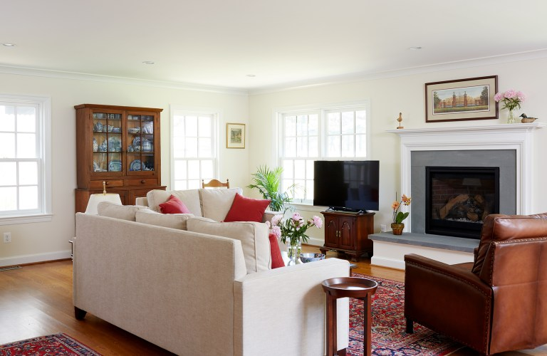 traditional living area light and bright with large windows and wood floors