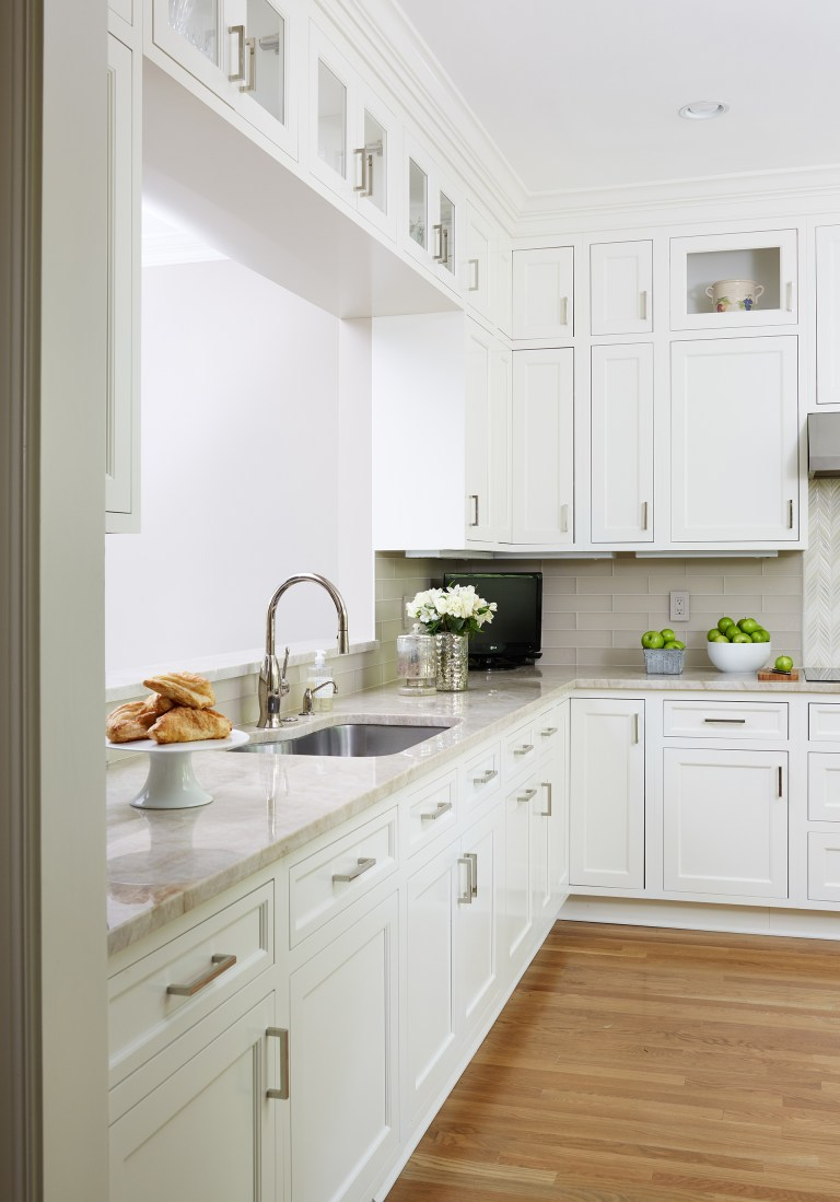 white and neutral toned kitchen with wood floors