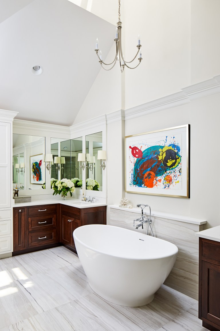 bathroom renovation ideas with a gorgeous freestanding tub along with a chandelier right above it sits between two vanity