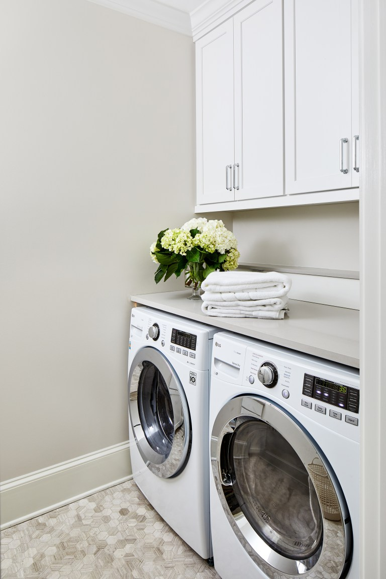 white laundry room cabinets set consist of four wall cabinets with large capacity washer & dryer