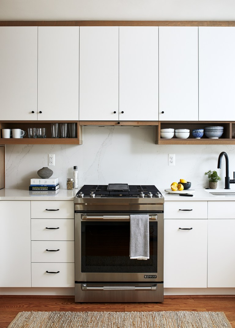 kitchen remodeling dc stainless steel appliances, white cabinets and hardwood flooring