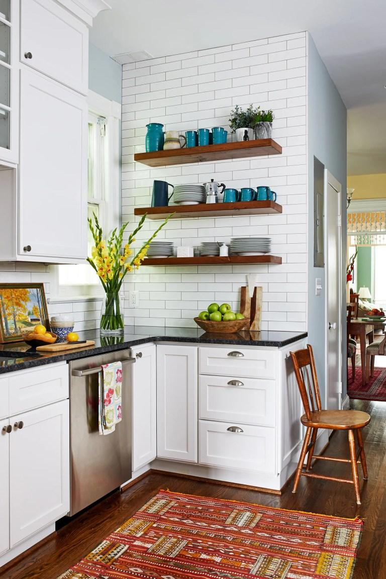 case design kitchen with wooden hanging shelves, wood flooring and white brink backsplash