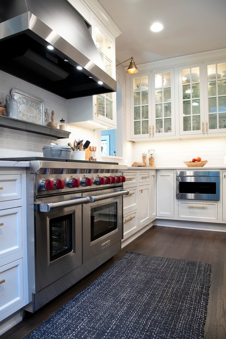 kitchen design with 6 burner stove top with double over and wood floors