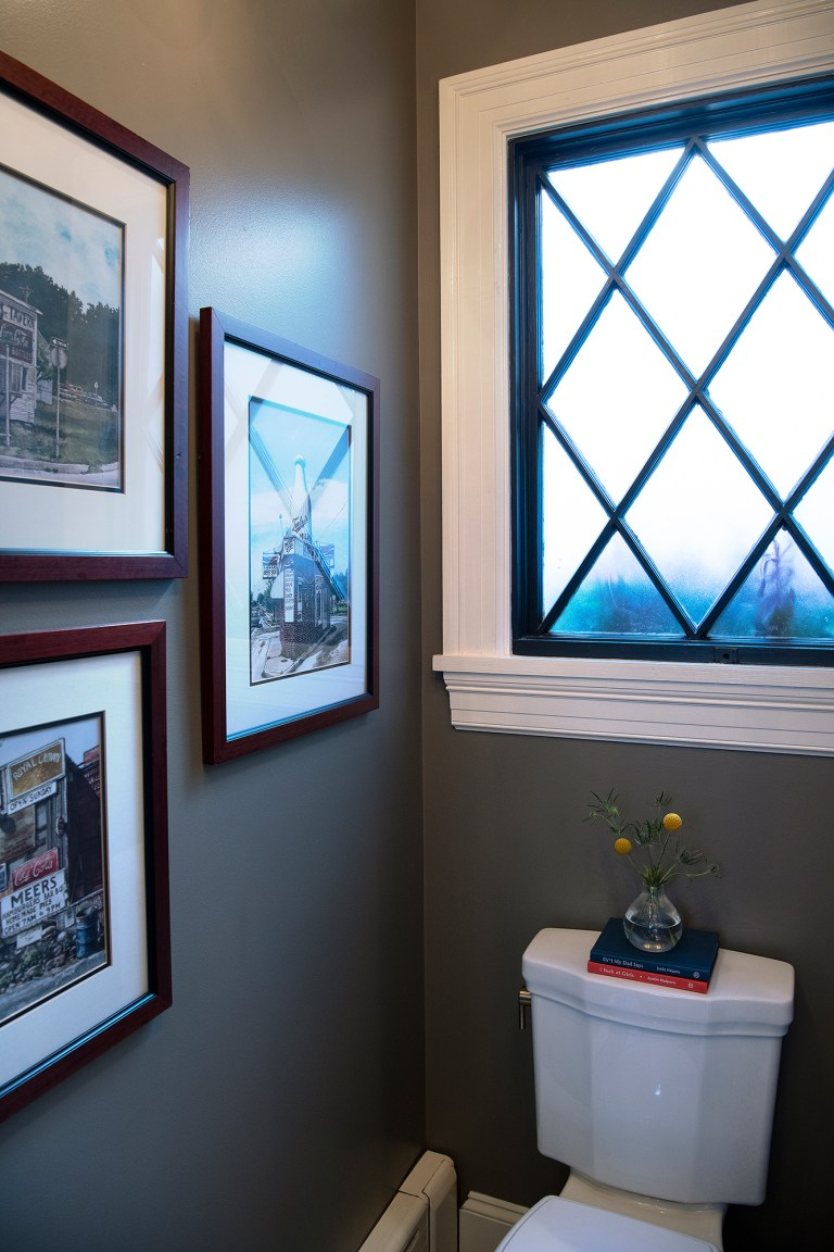remodeling bathroom with large window over the toilet