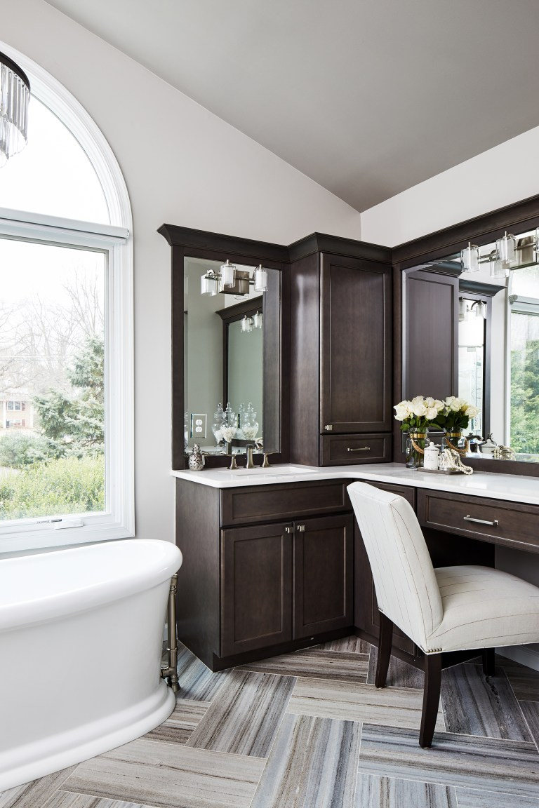 dark-colored finishes wood brown cabinets with large vanity with two mirrors