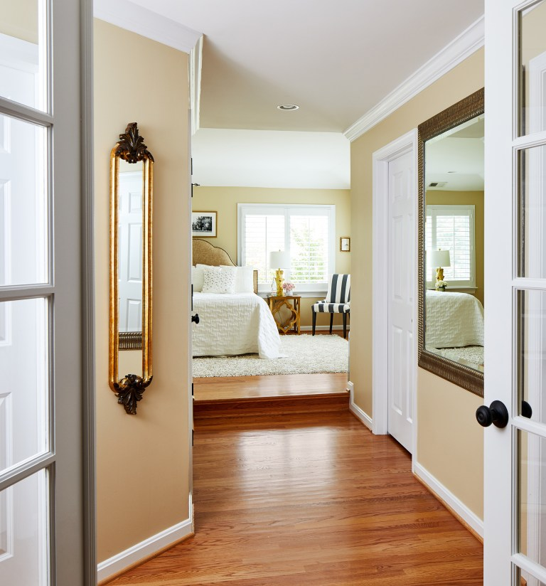 Double doors leading to master bedroom with hard wood flooring