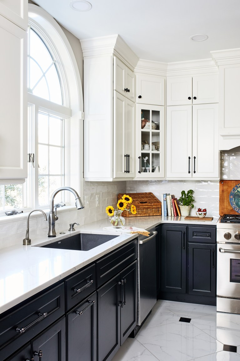 white and black kitchen cabinets window above large sink